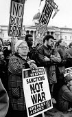 Protest against the Gulf War, Trafalgar Square, London 1991. CND Iraq Out Of Kuwait, Sanctions Not War, Give Peace A Chance - Melanie Friend - 12-01-1991