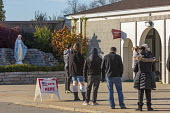 Michigan, USA, voters standing in line to vote, 2020 presidential election. watched by a statue of Mary, St. Joseph Chaldean Catholic Church - Jim West - 03-11-2020