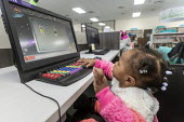 Detroit Public Library, USA, One year old using a computer - Jim West - 26-02-2020