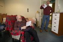 Warden explaining lockdown visitor restrictions to an elderly resident, sheltered accommodation, Broseley, Telford, Shropshire - John Harris - 03-11-2020