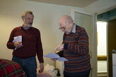Warden explaining lockdown visitor restrictions to an elderly resident, sheltered accommodation, Broseley, Telford, Shropshire - John Harris - 03-11-2020