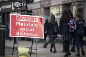Pupils walking home by Covid-19 Maintain Social Distance sign, Stratford Upon Avon, Warwickshire - John Harris - 10-11-2020