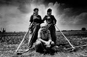 Albanian woman farmer with her daughters Kosovo 1989 pause from ploughing the fields, near Prizren - Melanie Friend - 17-05-1989