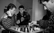East London 1998 Kosovo Albanian Asylum Seekers discussing chess moves, Ripple Hall Community centre, Barking and Dagenham - Melanie Friend - 12-10-1998
