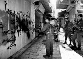 Old City, Jerusalem, 1991. Israeli soldiers cleaning away graffiti on first day of peace talks. Spraying from a backpack - Melanie Friend - 30-10-1991