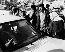 Jerusalem, 1984. Israeli contractor recruiting Palestinians for work in the construction industry, near Damascus Gate, Jerusalem, Israel - Melanie Friend - 29-03-1984