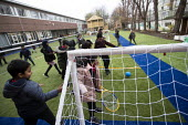 Playing football, breaktime, Lansbury Lawrence Primary School during Covid pandemic lockdown, Poplar, East London. - Jess Hurd - 27-11-2020