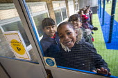 Pupils waiting to enter, Lansbury Lawrence Primary School during Covid pandemic lockdown, Poplar, East London. - Jess Hurd - 27-11-2020