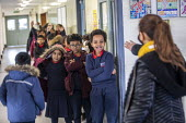 Pupils queuing, Lansbury Lawrence Primary School during Covid pandemic lockdown, Poplar, East London. - Jess Hurd - 27-11-2020