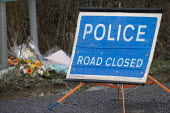 Flowers laid, Police road closed sign, Avonmouth explosion kills four. Wessex Water Treatment plant near Bristol. A chemical tank that treated biosolids exploded killing four including a teenager who... - Paul Box - 05-12-2020