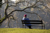 Woman sitting on a park bench overlooking the Avon gorge on first day of second lockdown, Autumn, Clifton Downs, Bristol - Paul Box - 05-11-2020