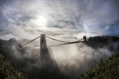 Clifton suspension bridge in fog, Clifton, Bristol. Morning mist surrounding the bridge spanning the Avon Gorge and the River Avon. A Grade I listed structure by Isambard Kingdom Brunel - Paul Box - 22-11-2020
