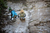 Autistic boy and brother sliding on the Clifton Rock Slide, Bristol. The Slidey Rock is a popular local play feature which has become shiny due to the generations of Bristolians who have slid down the... - Paul Box - 22-11-2020
