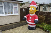 Inflatable Homer Simpson as Santa Claus, Telford. The Simpsons cartoon character Christmas decoration in the front garden of a bungalow - John Harris - 10-12-2020