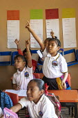 Brisas de Zicatela, Oaxaca, Mexico: Enthusiastic pupils with hands in the air, maths class. Escuela Primaria Tierra y Liberdad primary school - Jim West - 05-02-2020