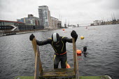 Open water swimming, Royal Docks, London. Swimming in the Dockside open water swimming area, London Royal Docks, East London. - Jess Hurd - 13-12-2020