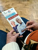 Pensioner receiving a Covid-19 Pfizer Vaccination, Clifton, Bristol. NHS Covid 19 Vaccination Service administering COVID-19 mRNA Vaccine BNT162b2 concentrate solution for injection, active immunisati... - Paul Box - 20-12-2020