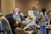 Florida USA uninsured patients getting free dental treatment by 1,000 volunteers at a free two-day Mission of Mercy dental clinic - Jim West - 22-04-2016