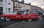 Get Set UK Santa in 1950's American car, streets of Putney London. Get Set Agency supply skills employment and training for Government funded programmes. Red 1959 Cadillac Eldorado, Get Set Go Ho ho h... - Duncan Phillips - 05-12-2020