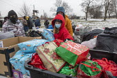 Detroit, USA Volunteers delivering Christmas gifts of warm clothing to people in need, most of them homeless, Roosevelt Park - Jim West - 19-12-2020