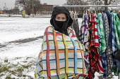 Detroit, USA Volunteers delivering Christmas gifts of warm clothing to people in need, most of them homeless, Roosevelt Park. Teenager Mackenzie Martin models the blanket wraps she and her sister make... - Jim West - 19-12-2020