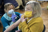 Pensioner receiving a Covid-19 Pfizer Vaccination, Clifton, Bristol. NHS Covid 19 Vaccination Service administering COVID-19 mRNA Vaccine BNT162b2 concentrate solution for injection, active immunisati... - Paul Box - 10-01-2021