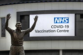 Covid-19 Mass Vaccination Centre Ashton Gate Stadium Bristol. John Atyeo statue - Paul Box - 11-01-2021