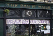 Pub closed, Covid 19 lockdown but allowed to sell take out beer, Bristol. Take away beer sign at The Bag of Nails - Paul Box - 06-01-2021
