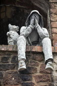 World Suicide Prevention Day, sculpture of a youth in a hoodie holding his head in his hands in dispair with a teddy bear comforting him, Bristol - Paul Box - 11-01-2021
