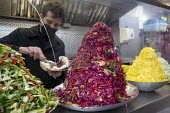 Matina Middle Eastern takeaway stall, St Nicholos market, Bristol. Allowed to continue trading during lockdown but is struggling as all office workers are working from home. Bristol. Middle Eastern gr... - Paul Box - 12-01-2021