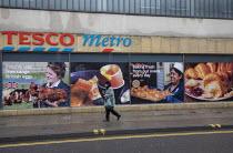 Tesco Metro, Broadmead, Bristol. Pedestrians in masks walking past advertismants for eggs and baking croissants - Paul Box - 12-01-2021