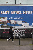 Defaced No Fake News Here billboard, Bristol. Global Media & Entertainment radio news services billboard advertisement reading Fake News Here - Paul Box - 20-01-2021