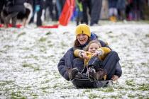 Children sledging in the snow, St Andrews Park, Bristol - Paul Box - 24-01-2021