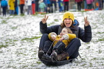 Children sledging in the snow, St Andrews Park, Bristol