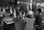 Women buying poultry, game stall market, Rome, Italy 1973 - Martin Mayer - 20-01-1973
