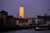 Canary Wharf glowing in the sunset, 1986 new financial centre in the docklands. The first building to go up was Canary Wharf - Martin Mayer - 01-10-1986