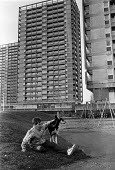 Child and dog, play area, tower blocks, Hackney, London 1988 - Peter Arkell - 18-03-1988