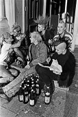 Punks relaxing with some cider, doorway, Hackney, London 1988 - Peter Arkell - 03-03-1988