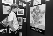 Pupil studying a Van Gogh, Highbury Grove School London 1989. Sunflowers at an exhibition - Peter Arkell - 30-06-1989