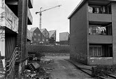 Old housing estate, The Isle of Dogs, East London, 1987 new buildings go up under the LDDC development scheme for the area near Canary Wharf. - Peter Arkell - 28-02-1987