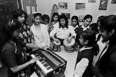 Choir of pupils originally from Bangladesh London 1988. Enabled by the ILEA they are from several different schools across the city. Harmonium player, Tabla and singing - Peter Arkell - 16-03-1988