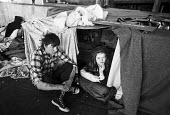 Homeless young couple sleeping rough, Cardboard City 1989 under the Bullring roundabout, Waterloo, London - Peter Arkell - 30-04-1989
