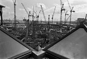View of Canary Wharf development, East London, 1989 Construction site and cranes - Peter Arkell - 12-06-1989