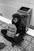 Homeless youth begging, London Underground, 1989. No Food, No Home, Please can you help sign - Peter Arkell - 15-04-1989