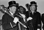 New mayor of Slough Vic Hills is sworn in, Berkshire, 1990. First black mayor - Peter Arkell - 03-04-1990