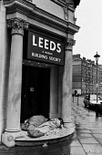 Homeless sleeping in the doorway of a Building Society, 1992. In the early hours of the morning two youths are sleeping rough in the enterence to a Leeds and Halifax Building Society branch - Peter Arkell - 15-07-1992