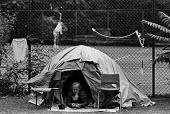 Homeless man in a tent next to tennis court, 1992, Lincoln's Inn Fields, Holborn, London - Peter Arkell - 08-06-1992