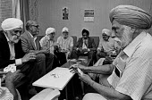 Sikh men playing cards, 1991. Council day centre and luncheon club, Greenwich, South London - Peter Arkell - 17-08-1991