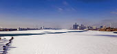 Detroit, USA: The partially frozen Detroit River. Downtown Detroit (R) and Windsor, Ontario, Canada - Jim West - 19-02-2021