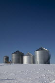 Sanilac Township, Michigan, USA: Steel grain storage silos in winter snow - Jim West - 20-02-2021